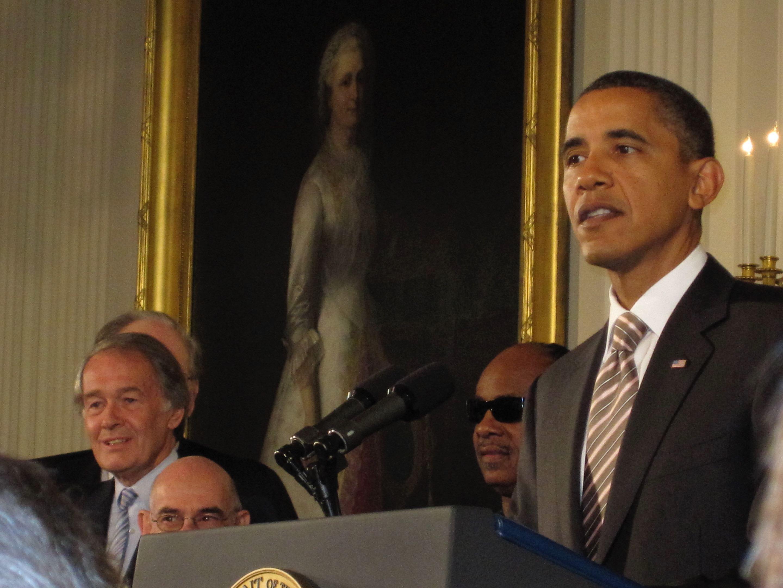 President Obama speaks at a podium.